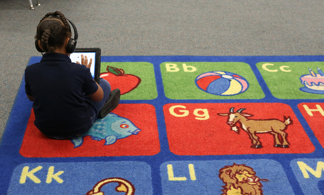 A pre-k student uses ipod at Kelly Elementary School Friday, April 29, 2016, in North Las Vegas. The Clark County School District recently removed and replaced the principal at Matt Kelly School.  ...
