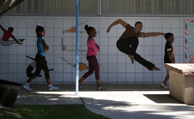 Fourth grade students at Kelly Elementary School walk past a mural as  they walk to their class Friday, April 29, 2016, in North Las Vegas. The Clark County School District recently removed and re ...