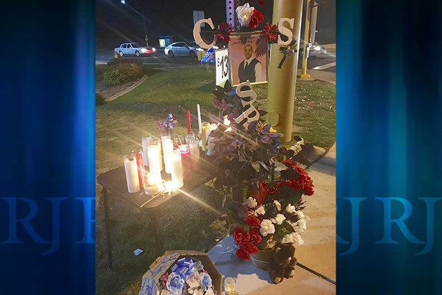 A memorial was created at the scene of the crash where Clay Stampley Sr. of North Las Vegas was killed Saturday, May 7, 2016, in a hit-and-run at West Cheyenne Avenue and Simmons Street. (Natalie  ...