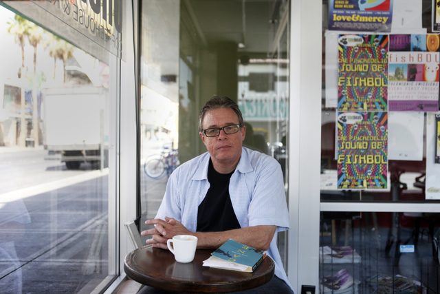 Clark County poet laureate Bruce Isaacson poses for a portrait at the Beat Coffehouse in July 2015. (James Tensuan/Las Vegas Review-Journal)
