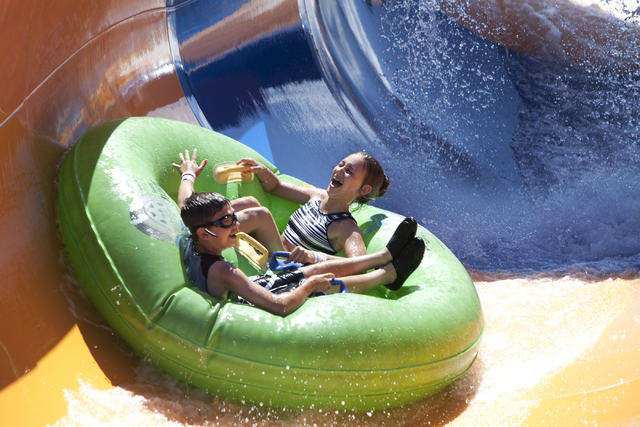 Ashlyn Runnfeldt and Jaeger Prince, both 12, slide down a ride at the Wet 'n' Wild in Las Vegas on Tuesday, May 31, 2016. Loren Townsley/Las Vegas Review-Journal Follow @lorentownsley