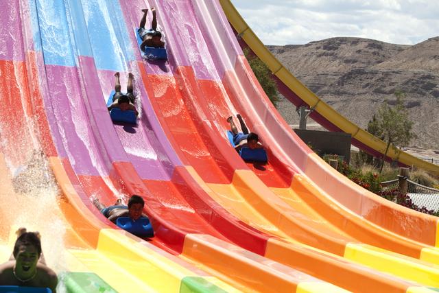 Kids slide down the Desert Racers at the Wet 'n' Wild in Las Vegas on Tuesday, May 31, 2016. Loren Townsley/Las Vegas Review-Journal Follow @lorentownsley