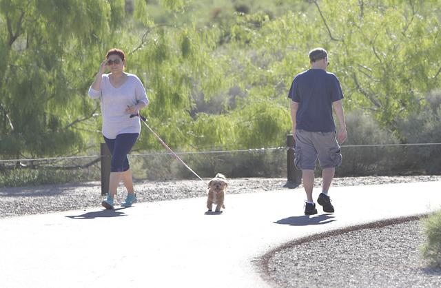 People walk as they enjoy the sunny weather on Monday, May 2, 2016, at Sunset Park in Las Vegas. (Bizuayehu Tesfaye/Las Vegas Review-Journal Follow @bizutesfaye)