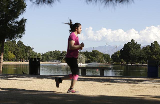 A woman jogs as she enjoys the sunny weather on Monday, May 2, 2016, at Sunset Park in Las Vegas. (Bizuayehu Tesfaye/Las Vegas Review-Journal Follow @bizutesfaye)