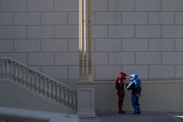 Two people in costumes stand in the shade near Caesars Palace casino-hotel on Tuesday, May 31, 2016, in Las Vegas. Erik Verduzco/Las Vegas Review-Journal Follow @Erik_Verduzco