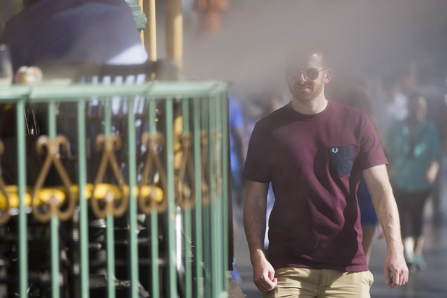 A man walks through mist near the Paris casino-hotel on Tuesday, May 31, 2016, in Las Vegas. Erik Verduzco/Las Vegas Review-Journal Follow @Erik_Verduzco