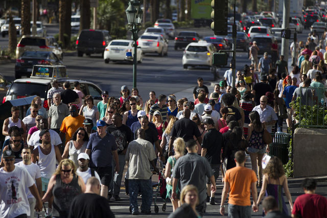 People walk near Planet Hollywood casino-hotel on Tuesday, May 31, 2016, in Las Vegas. Erik Verduzco/Las Vegas Review-Journal Follow @Erik_Verduzco