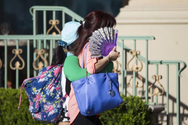People walk near the Paris casino-hotel on Tuesday, May 31, 2016, in Las Vegas. Erik Verduzco/Las Vegas Review-Journal Follow @Erik_Verduzco
