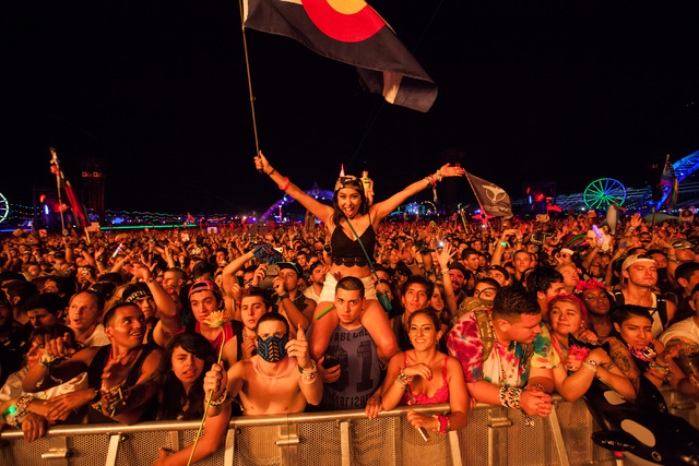 Attendees watch as Tiesto performs at the Kinetic Field stage at Electric Daisy Carnival at the Las Vegas Motor Speedway in Las Vegas during the early hours of Monday, June 22, 2015. (Chase Steven ...