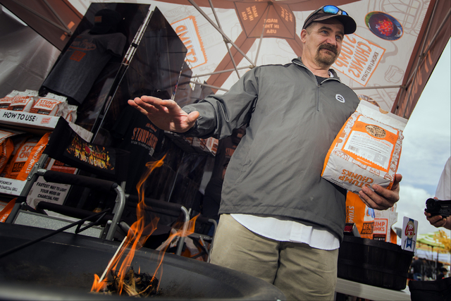 Sylvain Roy places his hand over fire starter at Stump Chunks booth Friday, May 6, 2016 at the 71st National Hardware Show in the Las Vegas Convention Center parking lot. Jeff Scheid/Las Vegas Rev ...