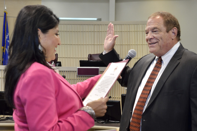 Rodney Burr, right, is sworn in as municipal judge by City Clerk Sabrina Mercadante at Henderson City Hall at 240 S. Water St. in Henderson on Tuesday, May 17, 2016. Bill Hughes/Las Vegas Review-J ...