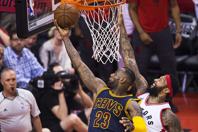 Cleveland Cavaliers forward LeBron James (23) drives past Toronto Raptors forward James Johnson during the second half of Game 6 of the NBA basketball Eastern Conference finals, Friday, May 27, 20 ...