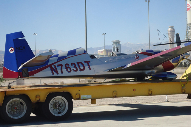 A Sky Combat Ace stunt plane sits on truck bed after its pilot made an emergency landing Oct. 26, 2014 at McCarran International Airport with a passenger on board. National Transportation Safety B ...