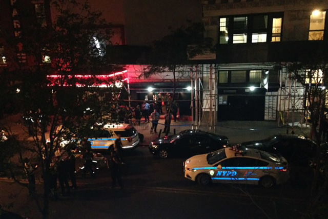 Authorities stand outside Irving Plaza, near Manhattan's Union Square in New York after a shooting Wednesday, May 25, 2016. Police say several were injured in a deadly shooting inside the concert  ...