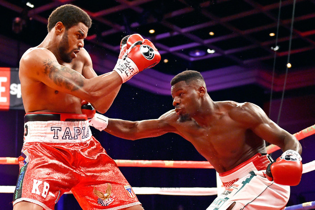 Andrew Tabiti, right, of Las Vegas throws a right at Keith Tapia of New York during a cruiserweight fight at Sam's Town hotel-casino Friday, May 13, 2016, in Las Vegas. Tabiti won by a unanimous d ...