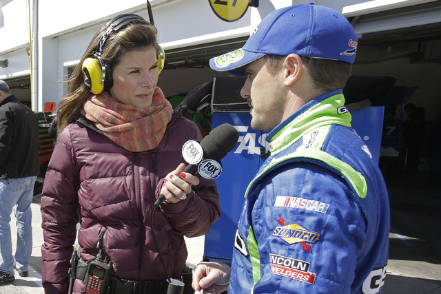 Fox motor sports journalist Jamie Little, center, interviews driver Casey Mears, right, in the garage area during a practice for the Daytona 500 NASCAR Sprint Cup Series auto race at Daytona Inter ...