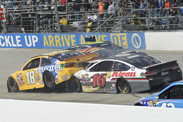 The car of Kyle Busch (18) is plowed into by Greg Biffle (16) as Jimmie Johnson (48) continues to wreck along with Ryan Newman, center, during the NASCAR Sprint Cup series race May 15, 2016, at Do ...