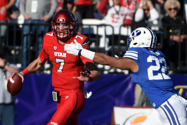 Dec 19, 2015; Las Vegas, NV, USA; Utah Utes quarterback Travis Wilson (7) is pressured by Brigham Young Cougars linebacker Manoa Pikula (22) in the Las Vegas Bowl at Sam Boyd Stadium. (Kirby Lee/U ...