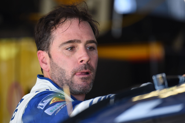 Jimmie Johnson prepares to go back out on the track during Sprint Cup Series afternoon practice at Kansas Speedway in Kansas City, Kan., Friday, May 6, 2016. (AP Photo/Reed Hoffmann)