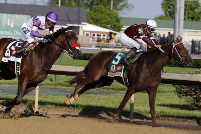 Nyquist (13) and Gun Runner (5) race in the Kentucky Derby on May 7, 2016, in Louisville, Ky. (Julio Cortez/Associated Press)