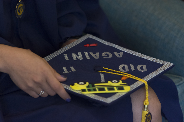 WSU Nevada graduate Silvia Mendoza-Stout holds her graduation cap as she speaks with a reporter prior to the school's first commencement ceremony at Hilton Lake Las Vegas Resort & Spa on Satur ...