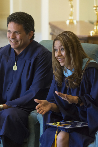 WSU Nevada graduates, James Lemmons Jr., left, and Silvia Mendoza-Stout speak with a reporter prior to the school's first commencement ceremony at Hilton Lake Las Vegas Resort & Spa on Saturda ...