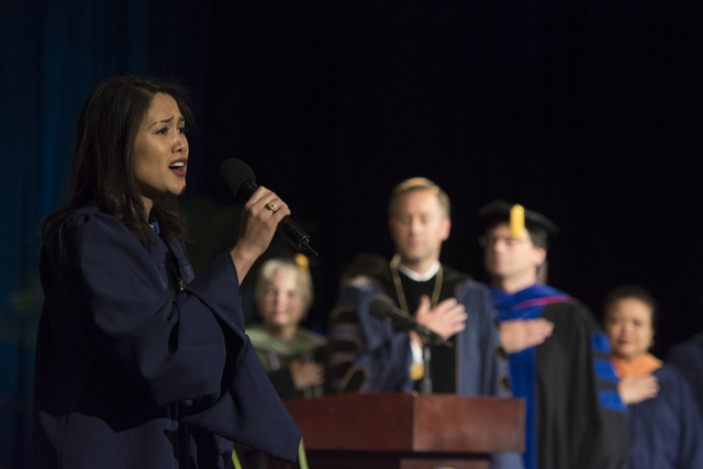 "WGU Nevada graduate Cheryl White, left, sings The Star-Spangled Banner"" during the school's first commencement ceremony at Hilton Lake Las Vegas Resort & Spa on Saturday, May 21, 2016. (Jason  ..."