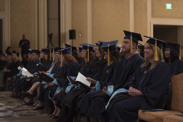 WSU Nevada graduates listen as Nevada Lt. Gov. Mark Hutchison delivers commencement address during the school's first commencement ceremony at Hilton Lake Las Vegas Resort & Spa on Saturday, M ...