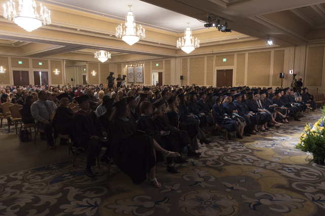 WSU Nevada graduates and their families listen as Nevada Lt. Gov. Mark Hutchison delivers commencement address during the school's first commencement ceremony at Hilton Lake Las Vegas Resort & ...