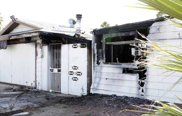 Fire damaged homes on 5138 and 5128 Wilbur St. are shown on Tuesday, May 31, 2016. One person was displaced after a fire damaged two neighboring homes near McCarran International Airport. Bizuayeh ...