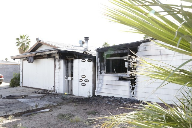 Two houses set close to each other, at 5138 and 5128 Wilbur St. in southeast Las Vegas, were damaged by fire early Tuesday, May 31, 2016. (Bizuayehu Tesfaye/Las Vegas Review-Journal Follow @bizute ...