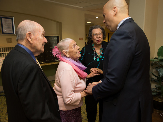 U.S. Sen. Cory Booker, right, greets guests alongside his mother, Carolyn, center, during a May 7, 2016, Mother's Day-themed event at Las Ventanas in Summerlin. Richard Brian/Special to View