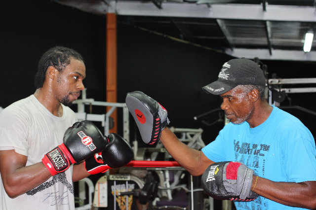 John Jackson, left, trains with his father, Julian Jackson, a former junior middleweight champion. John Jackson could earn his own belt by defeating Jermell Charlo on Saturday at the Cosmopolitan. ...