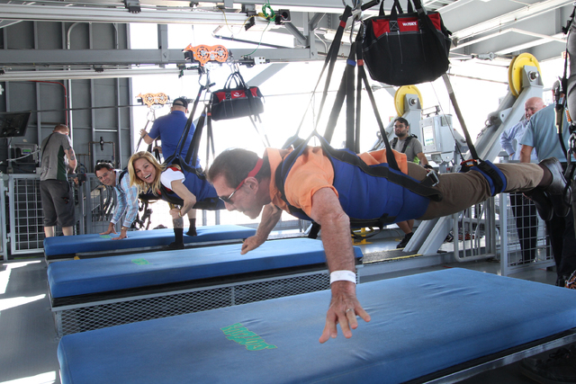 """Steve Wynn tries out the """"Zoomline"""" at the SlotZilla attraction downtown on Monday, May 16, 2016. (Scott Roeben/VitalVegas.com)"""