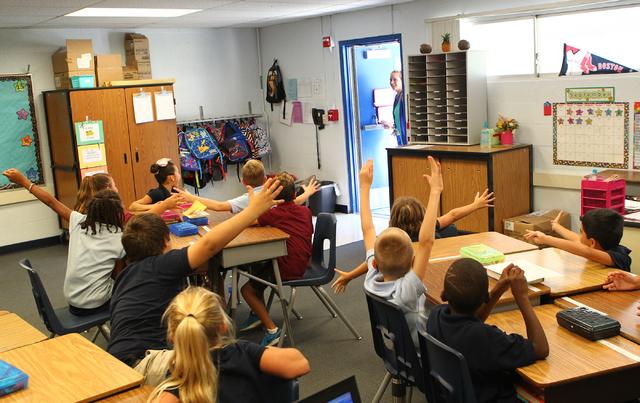Students surprise third grade teacher Brenda Moynihan at Sewell Elementary School in Henderson on Wednesday, Sept. 10, 2014. (Chase Stevens/Las Vegas Review-Journal)
