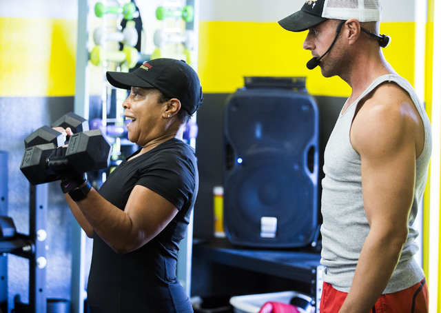 Katrina Harris,left,  does a bicep curls under while trainer Reinier Geyser watches her during a Power Hour 360 class at Darling Tennis Center, 7901 W. Washington Ave. on Monday, June 13, 2016. Je ...