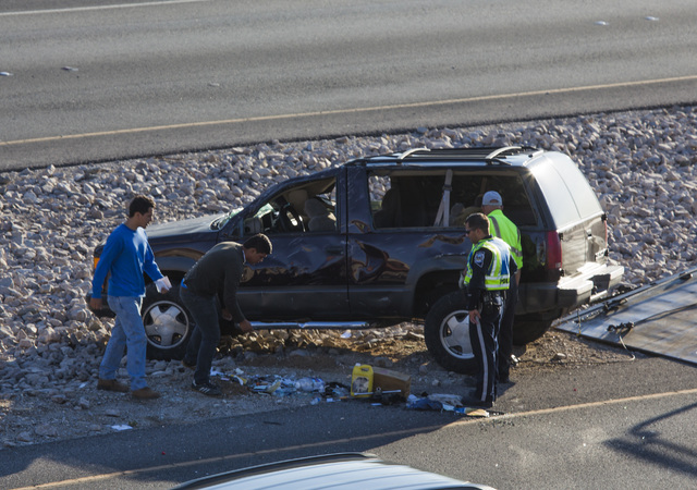 A Chevy Tahoe, westbound on the Summerlin Parkway, rolled across the median near Anasazi Drive on Wednesday morning, Aug. 6, 2014.  (Jeff Scheid/Las Vegas Review-Journal)