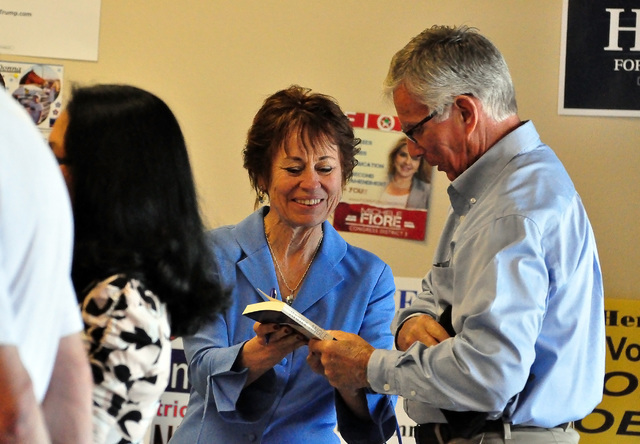 U.S. Senate hopeful Sharon Angle autographs a copy of her book for county commission candidate A.J. Dodd during a Republican party meet and greet Saturday. (Horace Langford Jr./Pahrump Valley Times)