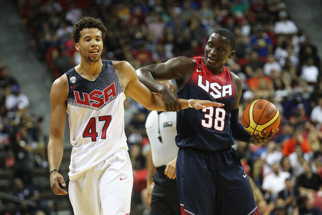 Victor Oladipo (38) jokes after being fouled by Michael Carter-Williams (47) during the USA Basketball Showcase game at the Thomas & Mack Center in Las Vegas on Thursday, Aug. 13, 2015. CHASE  ...