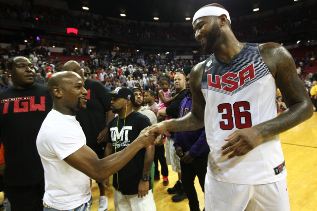 Floyd Mayweather Jr. greets DeMarcus Cousins (36) following the USA Basketball Showcase game at the Thomas & Mack Center in Las Vegas on Thursday, Aug. 13, 2015. CHASE STEVENS/LAS VEGAS REVIEW ...