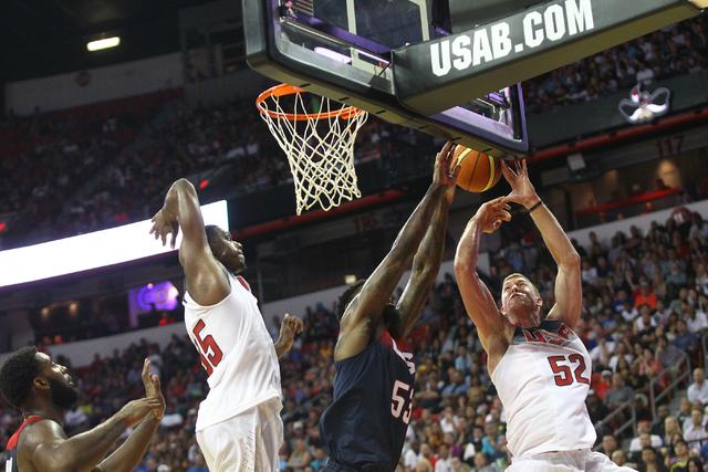 Mason Plumlee (52) goes up for the ball against Amir Johnson during the USA Basketball Showcase game at the Thomas & Mack Center in Las Vegas on Thursday, Aug. 13, 2015. CHASE STEVENS/LAS VEGA ...