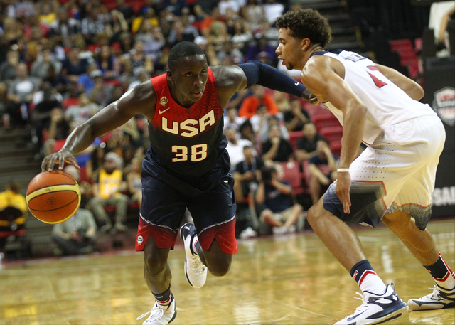 Victor Oladipo (38) drives against Michael Carter-Williams (47) during the USA Basketball Showcase game at the Thomas & Mack Center in Las Vegas on Thursday, Aug. 13, 2015. CHASE STEVENS/LAS V ...