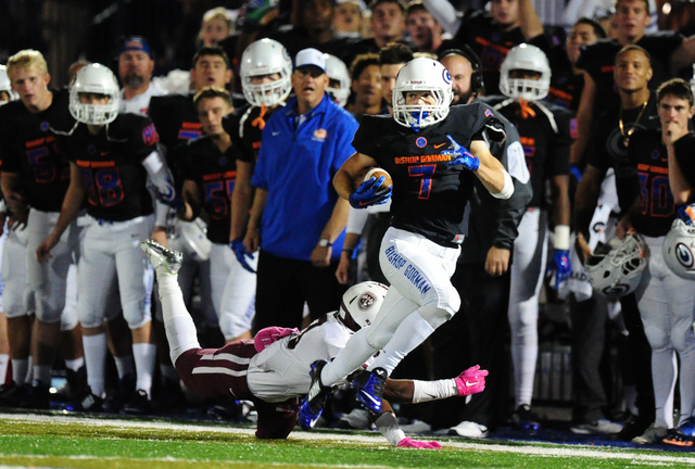 Bishop Gorman running back Biaggio Ali Walsh (7) runs past Don Bosco Prep Ironmen safety wide receiver Haraan Ransom for a first down in the first half of  their prep football game at Bishop Gorma ...