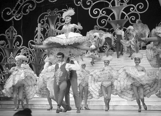 "A ""Folies Bergere"" showgirl in costume for the 1964 edition of the Tropicana revue. COURTESY LAS VEGAS NEWS BUREAU"