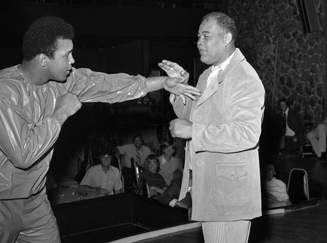 Muhammad Ali jokes with boxing legend Joe Louis during a workout at Caesars Palace in Las Vegas Thursday, Feb. 1, 1973. (Tony King/Las Vegas News Bureau)