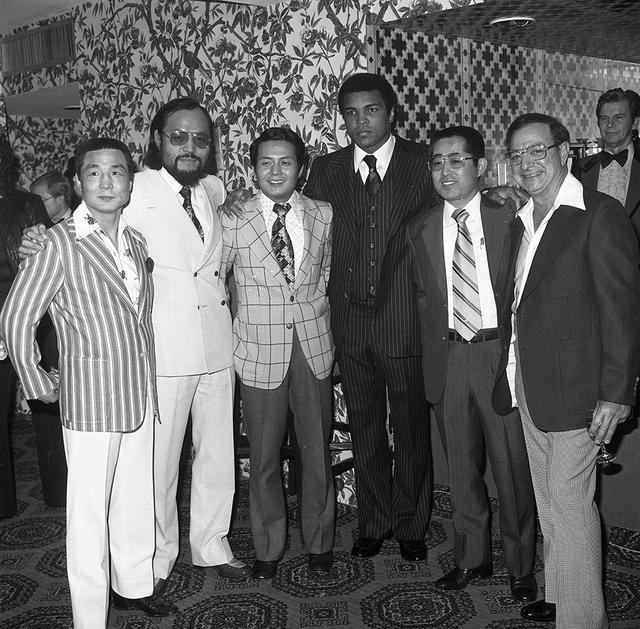 Muhammad Ali poses with guests at the Las Vegas Hilton Feb. 7, 1978. (Las Vegas News Bureau)