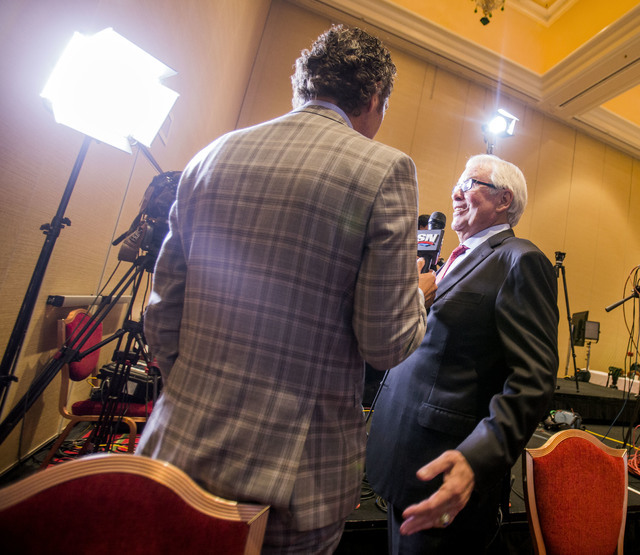 Bill Foley, right, Las Vegas billionaire businessman and owner of the new National Hockey League expansion team, is interview by Rogers SportsNet at Encore Las Vegas on Wednesday, June 22, 2016. J ...