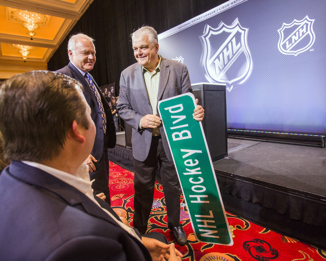 Clark County commissioner Steve Sisolak holds a street sign during the National Hockey League news conference to announce the new Las Vegas expansion team Wednesday, June 22, 2016 at Encore Las Ve ...