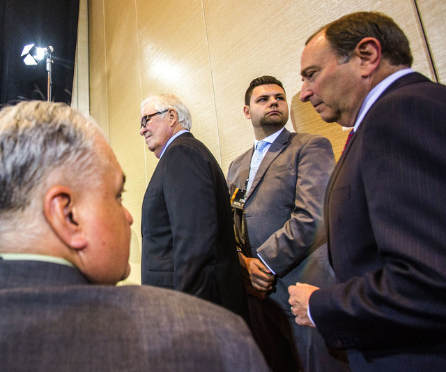 Bill Foley, center, a Las Vegas billionaire businessman and owner of the new National Hockey League expansion team and commissioner Gary Bettman, right, enter for a news conference at Encore Las V ...