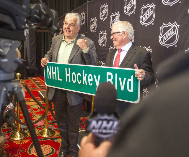 Clark County commissioner Steve Sisolak, left, presents Bill Foley, owner of Las Vegas' new National Hockey League expansion team, during a news conference at Encore Las Vegas on Wednesday, June 2 ...